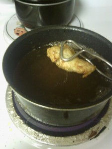 Chicken in the hot oil cooking beautifully!