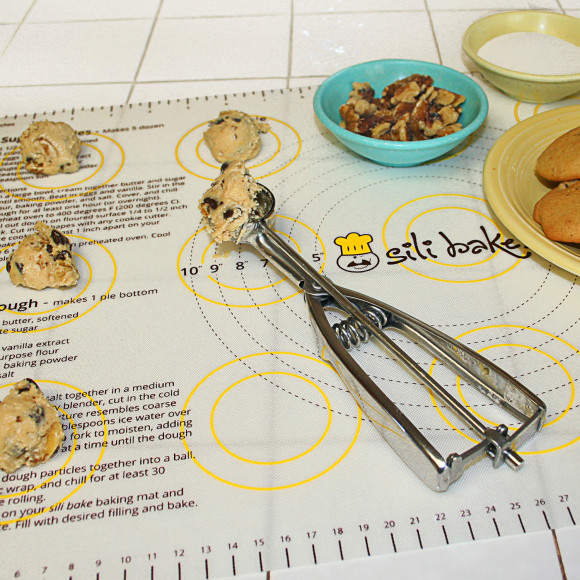 Pastry Mat for Baking with Measurements for Pizza, Pies, Cookies and Sheets of Dough. Silicone of Highest Grade FDA Certified. Sticks to Countertop, Durable and Reusable. Non Stick and Non Slip. Displays Weight, Oven and Liquids Conversions Right at Your Fingertips.